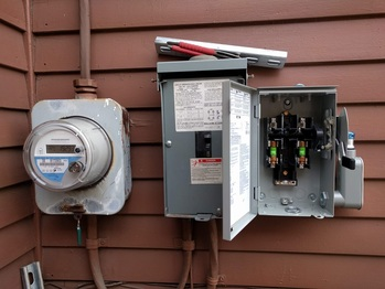 Solar AC disconnect on the right
