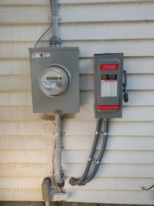 Utility meter and solar AC disconnect