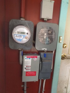 Utility meter with AC disconnect