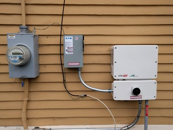 Inverter and AC disconnect on the house