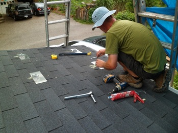 Installing PV mounts on the porch roof