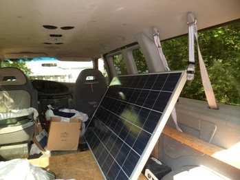 Loading the panels in the van