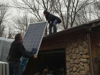 Handing up the first solar panel
