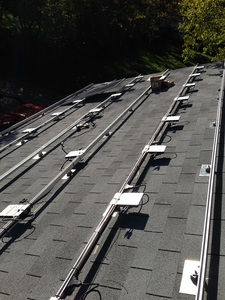 Rails and microinverters installed