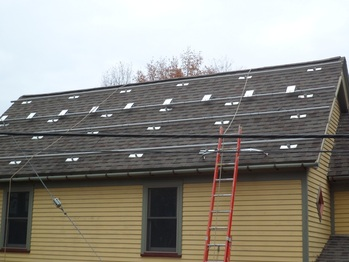 One row of micro-inverters installed