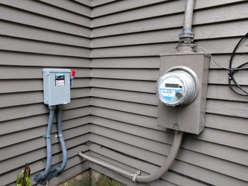 Solar AC disconnect next to utility meter