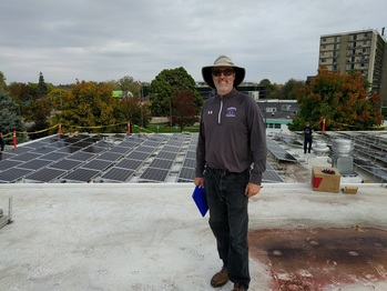 Solar contractor watching over the installation