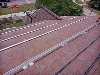 Flashing and rails on the South roof