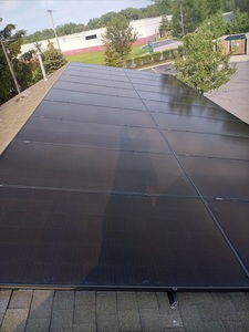 Finished panels on lower roof