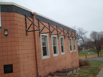 Awning frames on SouthWest wall