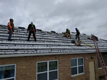 Installing the rails on a snowy roof