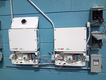 Inverters with solar AC disconnects