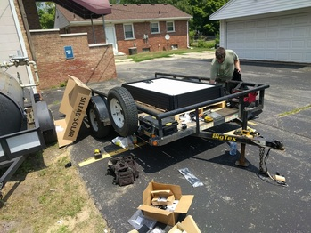 Hauling panels onto the roof