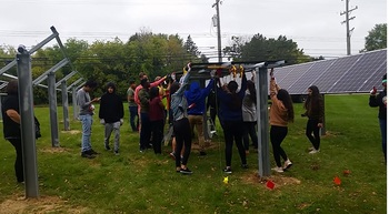 Students installing the panels