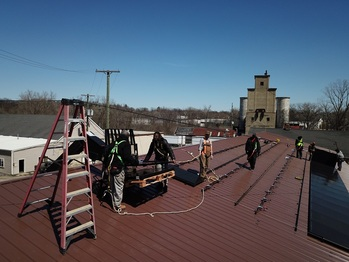 Expansion: Unloading panels on the roof