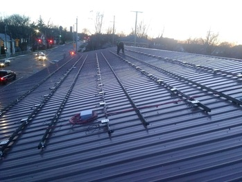 Expansion: Early morning, rails and optimizers installed